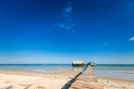Local seafood restaurant in beautiful fishermans village Ham Ninh, tropical Phu Quoc island (Bai Thom area) in Vietnam. Landscape taken during sunny day with blue sky.