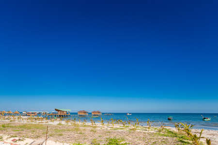 Local landscape in beautiful fishermans village Ham Ninh, tropical Phu Quoc island (Bai Thom area) in Vietnam. Landscape taken during sunny day with blue sky. 免版税图像