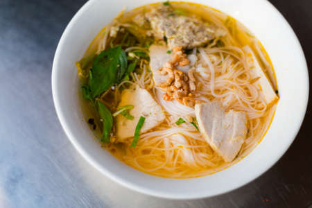 Delicious noodle soup Bun Tom Kho. Traditional vietnamese cuisine served in restaurant in Can Tho, Vietnam.
