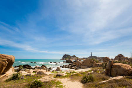 Summer seascape with Ke Ga Lighthouse in Vietnam. Landscape taken from the beach with blue sky on the south of Phan Tiet.