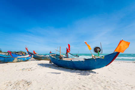 Vietnam coastal motorbike trip from Ba Ria to La Gi. Landscape with local sailboats, blue sky during sunny day on the south of Phan Tiet.