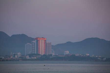 Beautiful golden sunrise on Nha Trang beach with cityline view, Khanh Hoa province in Vietnam.