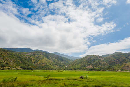 Beautiful photo of Cam Ranh fields with mountains in the background, Vietnam. Khanh Hoa province.