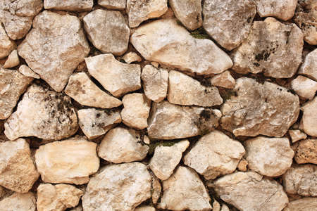 A good texture of rustic stone wall in the house in countryside