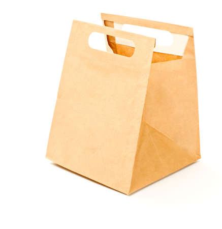 Paper brown lunch bag isolated photo