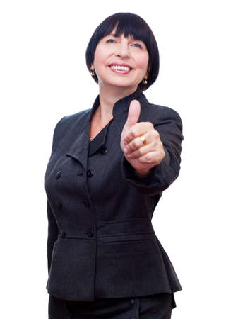 Mature business woman showing thumbs up, OK sign smiling happy. photo