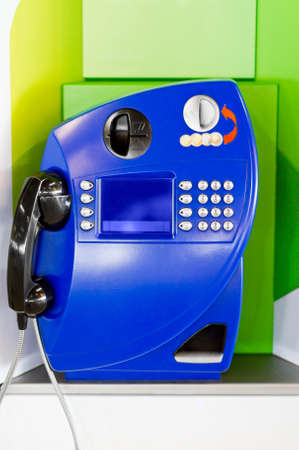 power operated: Blue public pay phone