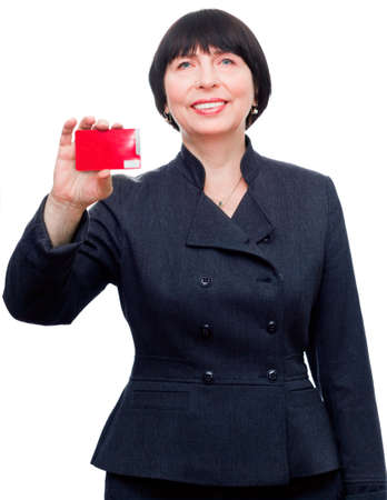 Confident mature smiling business woman holding a credit card photo