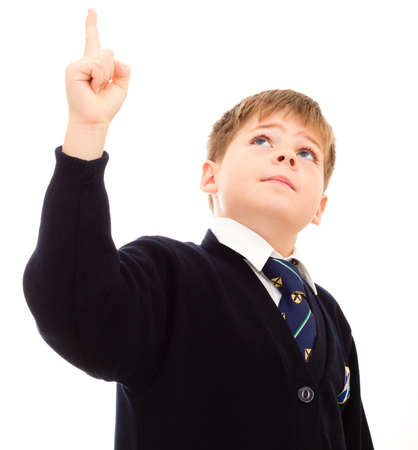 uniform student: Schoolboy in his uniform points upwards. Isolated on white. Stock Photo