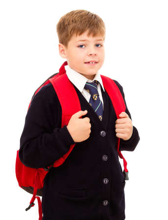 Schoolboy standing with his backpack  Wearing in school uniform  Isolated on white  photo