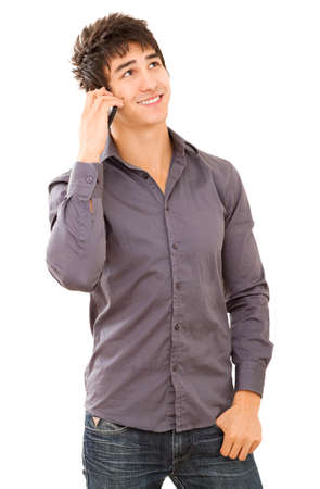 Happy smiling young man talking on mobile phone. Isolated on white. Stock Photo - 16494321