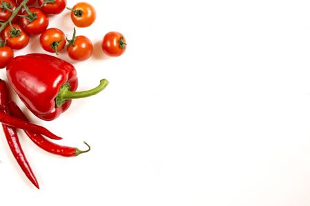free space: Tomatoes red pepper  on a white white background free space top view