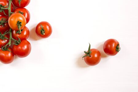 red cherry tomatoes on a white background top view