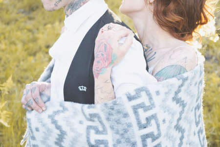 bridegroom: Bride embraces bridegroom covered with a rug Stock Photo