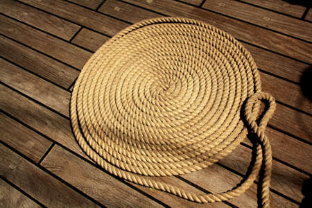 Boat rope circles on wooden deck. Background.