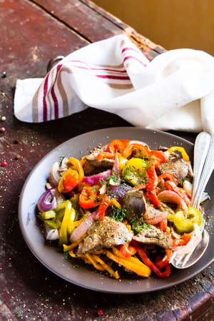 Warm salad with chicken liver and sweet pepper Stock Photo