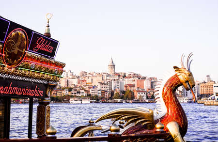 Istanbul  Turkey - September 25, 2014: Cityscape of Galata (modern Karakoy) with the Galata Tower and Balik Ekmek fish boat shop in Istanbul. Image with copy space. Editorial