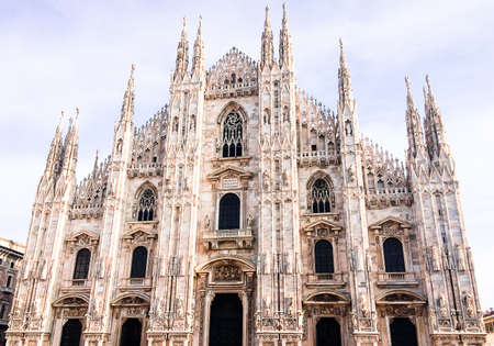 Facade of Milan Cathedral (Duomo) from the Square Piazza del Duomo, Lombardy, Italy. The largest church in Italy. Image with copy space. Stock Photo