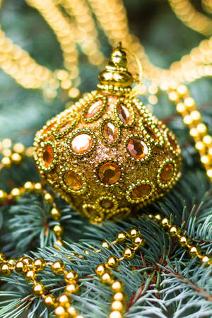 Golden tree christmas tree decoration selective focus. Christmas postcard. Holiday concept. Stock Photo