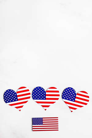 American Independence day background with blue, white and red mixed stars and hearts. Celebration of American Independence Day, the 4th of July (the Fourth of July). Holiday concept. With copy space. Stock Photo