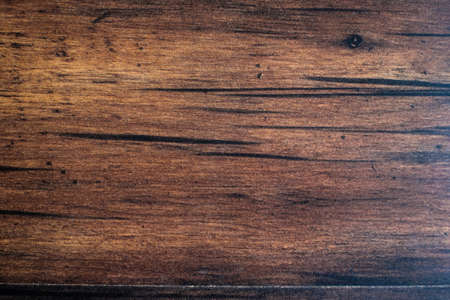 Brown scratched wooden cutting board. Wood texture. Wood background.