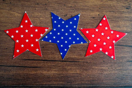 Red wood blue stars on wooden brown background. Holiday concept. Christmas postcard. With copy space.