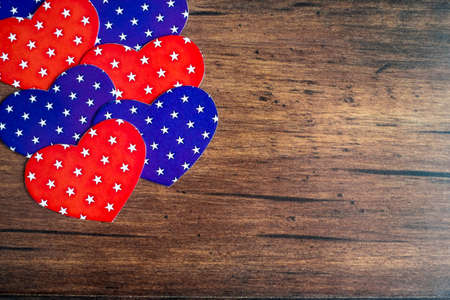Red and blue hearts on wooden brown background. Holiday concept. Valentines day postcard. With copy space.