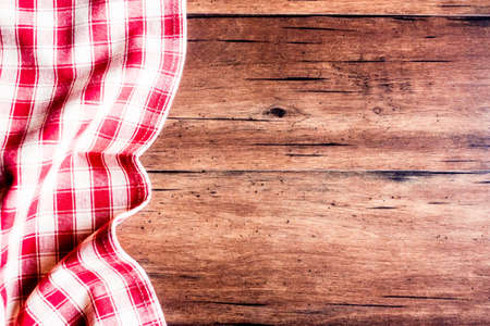 Checkered red napkin on an old wooden brown