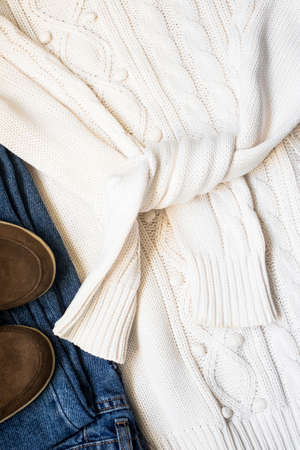 Set of womens autumn, winter clothes - jeans, white pullover oversize, suede brown boots. 스톡 콘텐츠