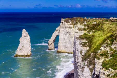 Etretat Aval cliff, rocks and natural arch landmark and blue ocean. Normandy, France, Europe. Reklamní fotografie