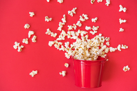 popcorn in a red bucket on a red background