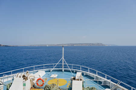 ship bow: View to the sea, land and passing ship from the bow of the ship Stock Photo