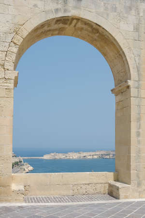 stone arch: Sea view through a large stone arch