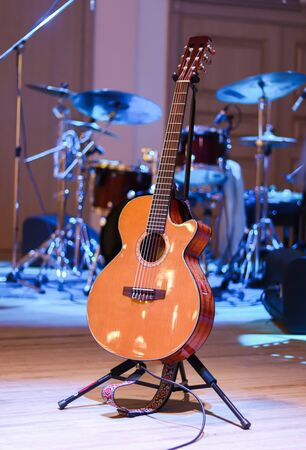 Acoustic guitar and percussion on the scene at concert 写真素材