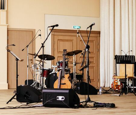 Acoustic guitar and percussion on the scene in concert 写真素材