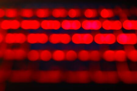 Unfocused blured red and black background bokeh. Blurred bright light