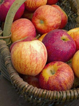 Fresh red apples in weaved basket. photo
