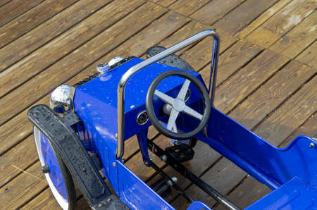 Blue pedal car for children to play with. photo
