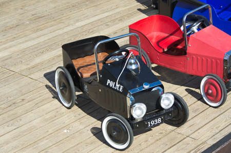 Old pedal cars for children to play with. photo