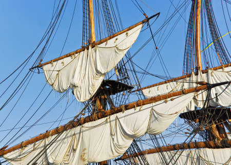 tall ship: Masts with sails on a large sailing ship.