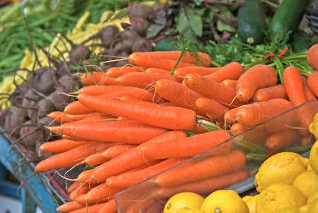 market stall: Carrots and other vegetables in a market stall