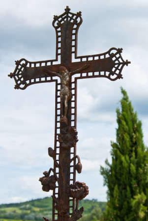 Iron cross with crucifix on a cemetery in French  Stock Photo - 13106836