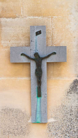 Tombstone with crucifix on a cemetery in France  photo
