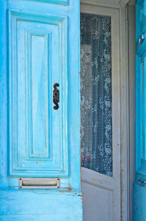 mail slot: Blue front door with a mail slot