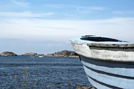 Bow of old wooden boat and ocean in background  photo