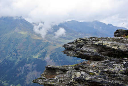 View over a mountainous landscape a cloudy day in Austria. photo
