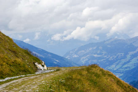 foot path: Foot path in a mountainous landscape Stock Photo