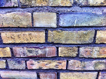 architecture: Wall build of yellow brick stones  Stock Photo