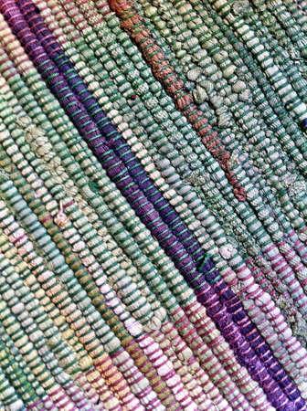 woven: Woven rag carpet.