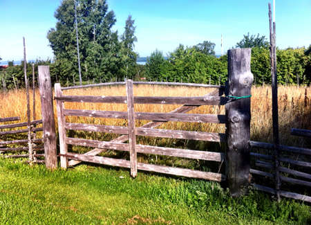 fence: Landscape with wooden fence and gate